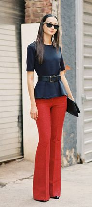 - black peplum top, black chunky belt, black clutch, high waisted red pants outfit HotWomensClothes.com- This is so flattering!