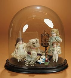 A Vignette of German All-Bisque Dolls in Play Scene in Glass Dome 400/600
