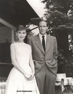 "Audrey Hepburn photographed with husband Mel Ferrer in the yard of ""Villa Bethania"", a charming villa in Bürgenstock (Switzerland), before a press conference, in June 1955"