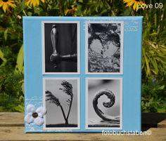 """Foto-Wortschild """"LOVE"""" auf einer bestempelten hellblauen Leinwand mit Dekoblümchen"""