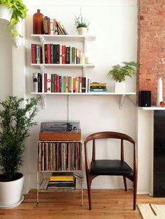 record cart, vintage chair, tiered shelves, brick