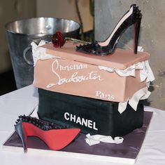 Louboutin studded shoes in sugar atop two cake shoe boxes with edible tissue paper