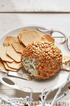 Toasted pine nuts look lovely on the outside of a creamy, herb-filled cheese ball. You won't have to encourage your guests to dig into this gorgeous holiday appetizer! It's the perfect Thanksgiving ap Best Holiday Appetizers, New Year's Eve Appetizers, Cheese Appetizers, Thanksgiving Appetizers, Appetizer Recipes, Holiday Recipes, Appetizer Ideas, Thanksgiving Recipes, Holiday Parties