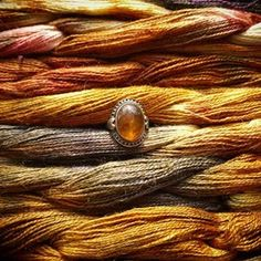"""This ring was the inspiration for """"Amber"""". I got it as a pressent from my aunty when i was a teenager. Ever sinds i have been fascinated by the millions of years old tree rasin and i love the colours. Silk/nettle warp by @saltwaterrosethreads @loomtowrap #handweaving #handwoven #handdyed #handdyedwarp #handdyedsilk #handwovenbabywrap #handmade #diy #amberstone #amber"""