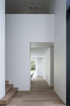 Stair Detail | White Walls | Black–Framed Glazing | Bleached Timber Flooring | Full–Height Curtains
