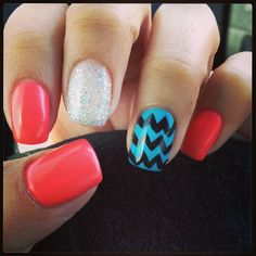 Coral nails with sparkle accent nail and blue and black chevron accent nail