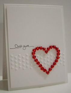 delightful handmade Valentine ... clean and simple ... band of tiny embossed hearts .... message: love you ... heart made up of an outline of small heart-shaped jewels ... great card!!!