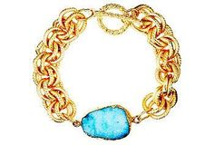 This bracelet features an aqua drusy stone hand-cast in 24-kt gold on a chunky link bracelet.