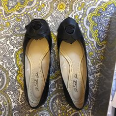 Brand new black flats Brand new never worn from Romantic Soles, size 7 black flats with a cute flower on the top. Perfect condition comes with box Romantic Soles Shoes Flats & Loafers