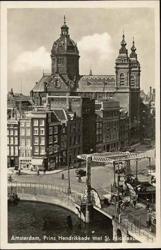 1940's. View on the Prins Hendrikkade in Amstedam with the Sint Nicolaaskerk. On the right the bridge over the Open Havenfront for traffic towards Centraal Station. Photo Hema. #amsterdam #1940 #PrinsHendrikkade #OpenHavenfront
