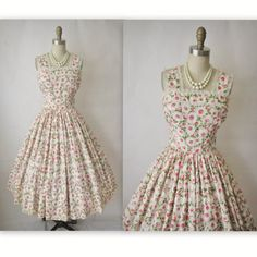 Cute vintage dress            Sweet 50's dress!     Features include:  * Classic silhouette  * Floral print fabric  * Lace-trimmed neckline & straps  * Full skirt   * Back metal zipper    Condition: excellent; bodice is lined in tulle and the skirt is unlined, so you would likely need to wear a slip   Label:   Bes...