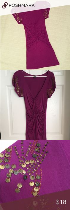 Free People sequin embellished Magenta dress Sz S Free People Jersey Dress, embellished with metal sequins and beads on the sleeves, cap sleeves with crisscrossing ruched front, low V Neckline.  Color: Magenta  Size: Small  Fabric: Viscose and spandex  In great condition. There is one sequin missing on one sleeve (see 3rd pic), but this is in no way obvious especially when worn. There is minor pilling but the dress is still in a great shape. No tear no stains.   Please let me know if you…
