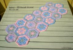 I have made a tablerunner with african flowers. includes link to a tutorial