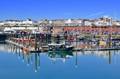 """This photograph of Ramsgate Kent was taken by Brian Whitehead on Tuesday. Brian says """"I noticed the reflections in the still water on what was a perfect summers morning"""". If you want your photograph to be considered for the #englandsbigpicture gallery send it to england@bbc.co.uk #england #picoftheday #photosofbritain #ukpotd #capturingbritain #ramsgate #kent #boats #reflection #summer"""