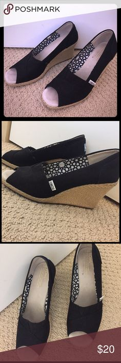 Black wedge Toms Bought from another posher and they are too small for me. Decent condition black wedge. No tears or stains on material. Slight wear on inner sole and bottom. Toms brand, 8.5. TOMS Shoes Wedges