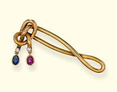 A SAPPHIRE, RUBY AND DIAMOND BROOCH, BY FABERGE   Of knot design with circular-cut diamond terminals, suspending an oval cabochon sapphire and ruby collet, circa 1900, 5.2 cm. wide, with St. Petersburg assay mark for gold (1908-1917)  Workmaster initials ES for Edward Wilhelm Schramm