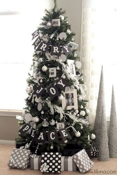Merry, Joy Peace Black & White Christmas Tree. See 15 amazing Christmas trees on www.prettymyparty.com.