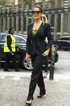 Salma Hayek London black suit green blouse