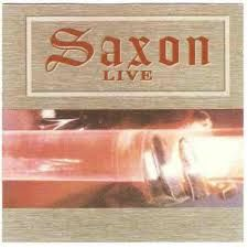 """Live trás a banda britânica de Heavy Metal, Saxon em uma performance ao vivo na Alemanha. Faixas 1. """"Interview With The Band"""" 3:01 2. """"Intro"""" 1:02 3. """"Motorcycle Man"""" 3:31 4. """"Still Fit To Boogie"""" 3:17 5. """"Freeway Mad"""" 2:38 6. """"Backs To The Wall"""" 4:09 7. """"Wheels Of Steel"""" 5:37 8. """"Babshooap"""" 6:29 9.…"""