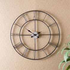 "$60.04 30"" dia, really generic design will look great in any room, will go with any décor style. Tell time with this stylish, powdercoated black, wall-mounting, minimalist and yet vintage metal wall clock. With its clean and very open design, it still hints at an elaborate old clock with its roman numerals and elegantly curving black hands."