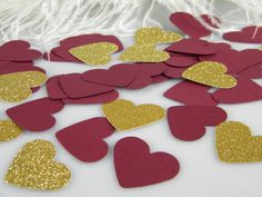 Burgundy and Gold Wedding Confetti Hearts | Table Scatter | Bridal Shower Baby Shower Decoration | Burgundy & Gold Party Decoration by MorrellDecor on Etsy https://www.etsy.com/listing/471462926/burgundy-and-gold-wedding-confetti