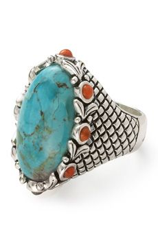 "Bansela Turquoise and orange sponge coral ring...Genuine Kingman turquoise is cut in a bold oval, surrounded with warm orange sponge coral rounds. Richly patterned silver overlay forms the smooth-to-the-touch band. Top of ring is 1.25"" long."