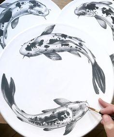 Painting many Koi on porcelain today. ⚪️#painting #koi #underglaze #blackandwhite #fish #porcelain #ceramics #pottery