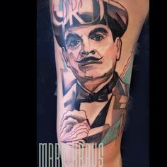 A tattoo of Hercule Poirot, based on a character created by Agatha Christie #literarytattoos