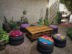 #Garden, #Patio, #Recycled Make some of these easy Tire Poufs and upcycle tires into comfortable, fun, and practical patio seating or party decor! Tire Poufs - who knew that worn tires could be upcycled into functional and cheery seating? You only need to find some used