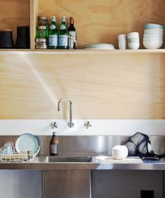 In the low-budget reno a commercial sink is teamed with Reece laundry tapware for the kitchen.