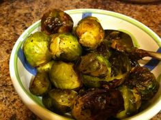 Crispy Roasted Brussels Sprouts from Kelly the Kitchen Cop - but don't put them in a plastic bag to coat them with oil and seasonings, just put them in a bowl and toss with your hands, or do it on the baking sheet.