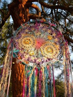 awesome.. awesome... yarnbombing, crochet, repurpose and scrap fabric and maybe a hula hoop?