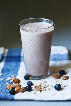 Morning Powerhouse Smoothie: banana, peanut butter, oats, almonds, Chia seeds, flax, coconut oil, berries, Greek yogurt, almond milk