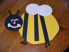 My favorite bee. Bend a metal coat hanger in shape of a bees body. Cut 2 pieces of yellow cardstock in shape of body and glue to front and back of hanger. Cut out the head, wings, tail etc from card stock and glue onto body. Add facial features. Good size.