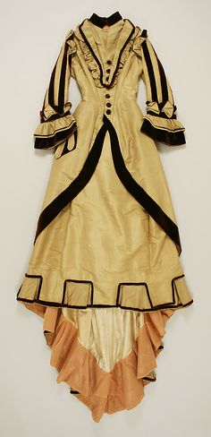 Dress, yellow with black trim  Date: 1872–74 Culture: American Medium: silk, cotton  Metropolitan Museum of Art  Accession Number: C.I.52.42.2a, b