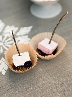 This easy-to-eat version of the bonfire dessert involves dipping skewered artisanal marshmallows in melted bittersweet chocolate and crushed graham crackers. #dessert