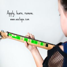 Apply, learn, remove. Master the notes on guitar or bass with AxeTape.  Available at www.axetape.com.