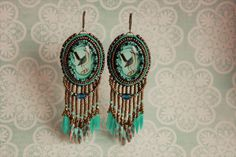 Earrings with birds.