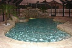 design for backyard pool just smaller love the rock scape