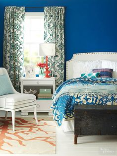 Don't be afraid of bold bedroom wall colors, but counteract with lighter furnishings. Love the pattern mix here as well.