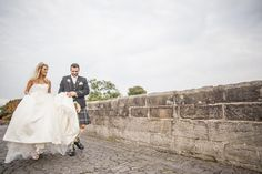 bride and groom enjoying each other while walking together across Stirling bridge Stirling Castle, Bridge, San Francisco, Groom, Walking, Wedding Photography, In This Moment, Couple Photos, Wedding Dresses