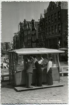 Original vintage 1955 HOLLAND Amsterdam fish seller postcard.