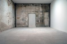 Old concrete wall  inside the Atelier Anton Corbjin by Dutch architects Bos Alkemade Architecten.