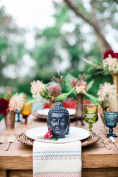 Buddha Place Setting East Asian Wedding Inspiration Photography : Elisabeth Arin Photography Read More on SMP: http://www.stylemepretty.com/california-weddings/2015/06/06/colorful-boho-wedding-inspiration-for-the-world-traveler/
