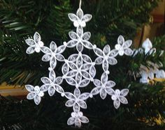 I have finished my design for the new year. Presenting my new 2011 Quilled Snowflake! Made from sturdy and beautiful paper quilling.  I have been making a yearly design since 2008. Every years design is unique unto itself.  There are 55 pieces that make up this approx. 4 Snowflake which hangs from a gold metallic thread.  Add alittle bit of snow to your Christmas tree with this beautiful design.  As with all my other ornaments it arrives in its own box for gifting or for storage.  Let it…