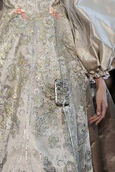 Silver brocade detail.