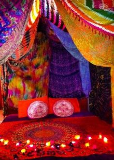 Gypsy style decor den. I want these colored drapes on my walls!