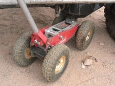 Offroad Jack - Homemade offroad jack adapted from a standard floor jack by means of mounting larger wheels and knobbed tires.