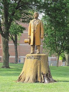 """Carved from a tree  -  This statue of Tauy Jones  was carved from a tree on the grounds of  the Franklin County, Kansas courthouse with a chainsaw. John Tecumseh  """"Tauy"""" Jones, honored as the""""Founder of Ottawa  University"""", was part Chippewa Indian and part white"""
