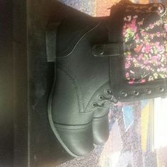 Black boots with floral lining inside Adjustable strap to convert from ankle boots to mid calf. Never worn. Shoes Ankle Boots & Booties
